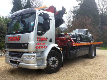 Tears recovery van transporting classic car