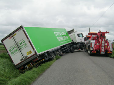 Commerical lorry being recovered out of a ditch