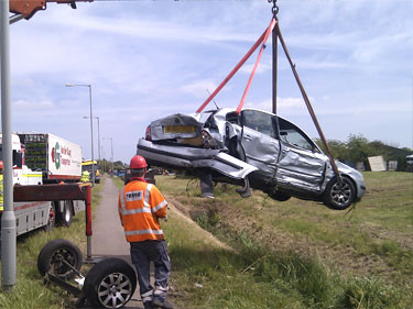 Winching light recovery car off side of road